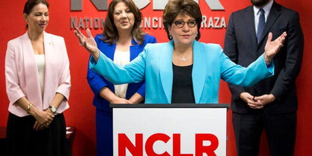 Janet Murguia, center, president of the National Council of La Raza (NCLR) speaks during a news conference, Thursday, April 7, 2016, in Miami. The NCLR, the nation's largest Hispanic civil rights organization, has launched a major voter-registration drive in the battleground state of Florida to identify and sign up hundreds of thousands of potential Hispanic voters. At rear from left are: Maria Garza, president of the Mexican American Council, Doral, Fla., city councilwoman Sandra Ruiz, and Miami Republican state Rep. Jose Felix Diaz. (AP Photo/Wilfredo Lee)