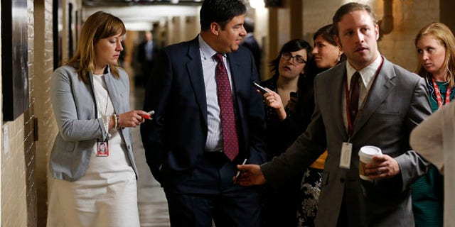 US Representative Raul Labrador talks to reporters gathered to ask members about House Majority Leader Eric Cantor's Republican primary election defeat in a hallway of the U.S. Capitol in Washington on June 11, 2014.