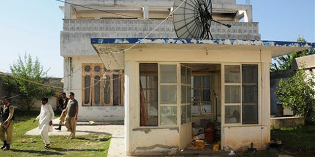 FILE - This photo shows the guesthouse inside Usama bin Laden's compound in Abbottabad, Pakistan.