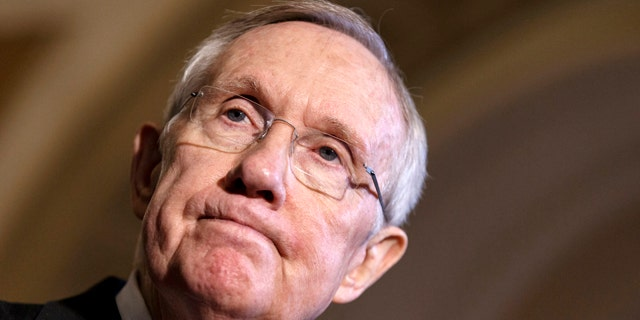File-This April 8, 2014, file photo shows Senate Majority Leader Harry Reid of Nev. pausing during a news conference on Capitol Hill in Washington. (AP Photo/J. Scott Applewhite, File)