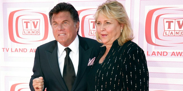 """Actor Larry Manetti, left, of """"Magnum, P.I."""" arrives at the TV Land Awards in Los Angeles, California, April 19, 2009."""