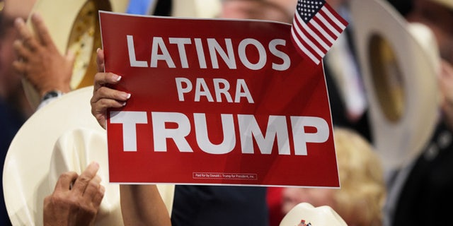 "CLEVELAND, OH - JULY 21:  A delegate holds up sign that reads ""Latinos Para Trump"" during the evening session on the fourth day of the Republican National Convention on July 21, 2016 at the Quicken Loans Arena in Cleveland, Ohio. Republican presidential candidate Donald Trump received the number of votes needed to secure the party's nomination. An estimated 50,000 people are expected in Cleveland, including hundreds of protesters and members of the media. The four-day Republican National Convention kicked off on July 18.  (Photo by Jeff Swensen/Getty Images)"