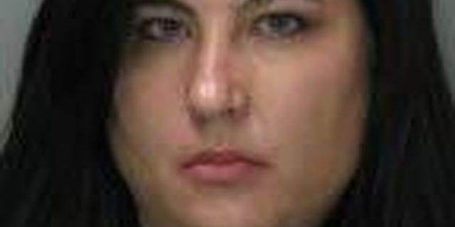 This photo provided by the Sacramento Police Dept. shows Laurie Ann Martinez. Martinez has been charged with faking her own rape in an unsuccessful bid to persuade her husband to move to a safer neighborhood in Sacramento, Calif.