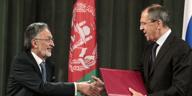 Nov. 25: Russia's Foreign Minister Sergei Lavrov, right, shakes hands with his Afghan counterpart Zalmay Rasul during a signing ceremony in Moscow, where Lavrov said Russia will allow NATO to take armored vehicles to Afghanistan through its territory under an expanded transit deal.