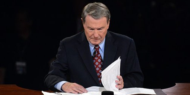 Oct. 3, 2012: Moderator Jim Lehrer looks over his notes before the first presidential debate at the University of Denver,  in Denver.