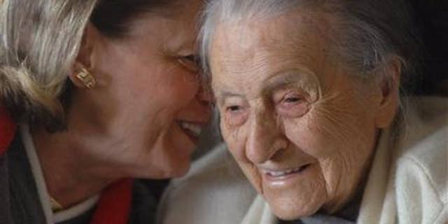 In a 2008 photo, Dr. Leila Denmark, right, listens to her grand niece Jackie Bennett as she celebrates her 110th birthday, in Athens, Ga. (AP Photo/Athens Banner Herald, Trevor Frey)