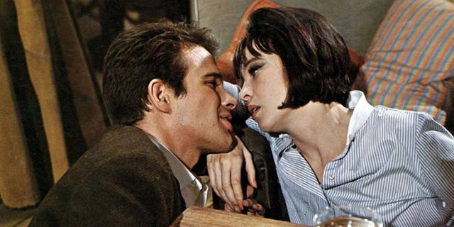 """Leslie Caron and Warren Beatty in 1965's """"Promise Her Anything""""."""