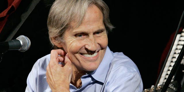 """FILE - In this Dec. 3, 2007 file photo, musician Levon Helm appears on the new """"Imus in the Morning"""" program at New York. Helm, who was in the final stages of his battle with cancer, died Thursday, April 19, 2012 in New York. He was 71. He was a key member of The Band and lent his distinctive Southern voice to classics like """"The Weight"""" and """"The Night They Drove Old Dixie Down."""""""