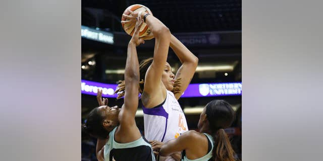 Phoenix Mercury's Brittney Griner looks to pass while being double-teamed by New York Liberty's Avery Warley, left, and Swin Cash during the first quarter of a WNBA basketball game Saturday, July 26, 2014, in Phoenix. (AP Photo/The Arizona Republic, Cheryl Evans)