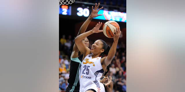 Connecticut Sun's Alyssa Thomas (25) drives past New York Liberty's Avery Warley during the first half of a WNBA basketball game in Uncasville, Conn., Sunday, June 15, 2014. (AP Photo/Fred Beckham)