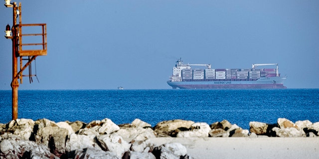 The Danish-flagged Alexander Maersk cargo ship off Sicily Monday, waiting to disembark 100 migrants it helped rescue Thursday in the Mediterranean Sea.  (AP Photo/Salvatore Cavalli)