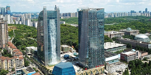 The Liebian Building is southwest China features a waterfall on its side.