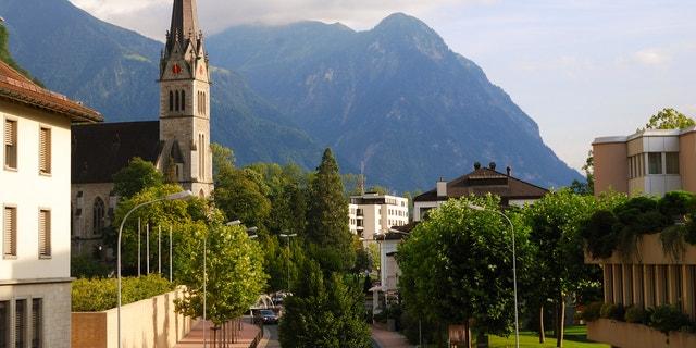 Vaduz church, street and Alps, Liechtenstein, panoramic view