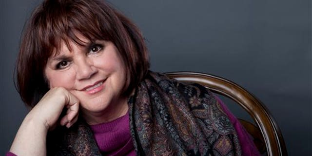 """FILE - In this Sept. 17, 2013 file photo, American musician Linda Ronstadt poses in New York to promote the release of her memoir """"Simple Dreams."""" Ronstadt will be inducted into the 2014 Rock and Roll Hall of Fame on April 10 at the Barclays Center in New York. (Photo by Amy Sussman/Invision/AP, File)"""