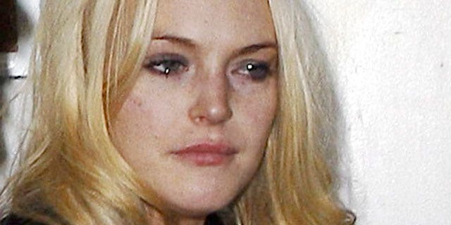 Nov. 7: A teary eyed Lindsay Lohan leaves Crown Bar in L.A., apparently skipping out on the bill!