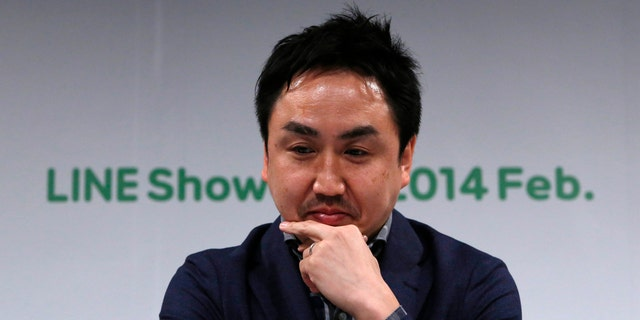 Takeshi Idezawa, chief operating officer of Line Corp, attends an announcement of its new service in Tokyo February 26.