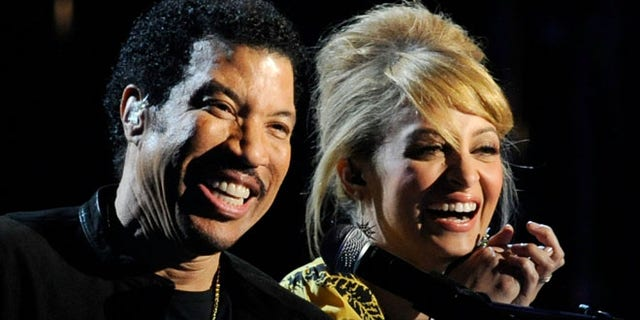 LAS VEGAS, NV - APRIL 02:  Musician Lionel Richie (L) and his daughter Nicole Richie perform onstage during Lionel Richie and Friends in Concert presented by ACM held at the MGM Grand Garden Arena on April 2, 2012 in Las Vegas, Nevada.  (Photo by Ethan Miller/Getty Images)