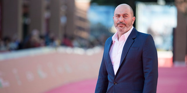 Actor Lior Raz poses for photographers as he arrives for the screening of the movie Fauda at Rome's Film Festival, in Rome, Saturday, Oct. 17, 2015. (AP Photo/Andrew Medichini)