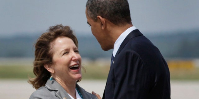 FILE - In this June 13, 2011, file photo, President Barack Obama is greeted by Sen. Kay Hagan, D-N.C. as he arrives at Raleigh-Durham International Airport, in Morrisville, N.C. Far from reversing course, Senate Democrats who backed Obama's health care law and now face re-election in GOP-leaning states are reinforcing their support for the overhaul even as Republicans intensify their criticism.  Mark Begich of Alaska, Mark Pryor of Arkansas, Mary Landrieu of Louisiana and Hagan will face voters in 2014 for the first time since voting for the Affordable Care Act _ commonly called Obamacare _ three years ago. (AP Photo/Carolyn Kaster, File)