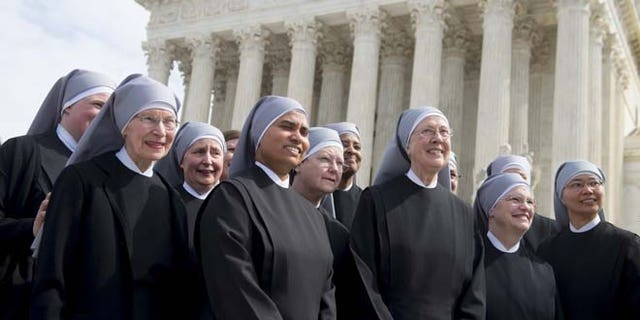 Loraine Marie Maguire (3rd R), mother provincial of the Little Sisters of the Poor, stands alongside fellow nuns following oral arguments in 7 cases dealing with religious organizations that want to ban contraceptives from their health insurance policies on religious grounds at the Supreme Court in Washington, DC, March 23, 2016.