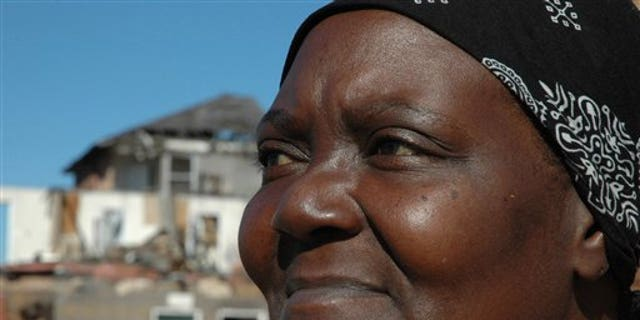 Jan. 3: Geraldine Horton, 53, pauses in tornado-ravaged Graceland Apartments in Tuscaloosa, Ala.