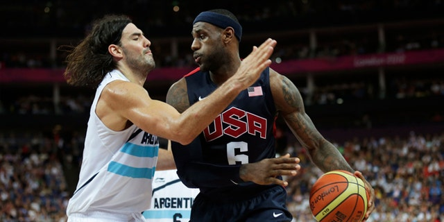Aug. 10, 2012: United States' LeBron James, right, prepares to drive on Argentina's Luis Scola during a men's semifinals basketball game at the 2012 Summer Olympics in London.