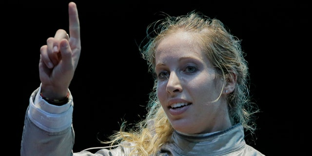 Aug. 1, 2012: The United States' Mariel Zagunis asks for a ruling in her match against Japan's Seira Nakayama in the women's individual sabre fencing competition at the 2012 Summer Olympics in London.