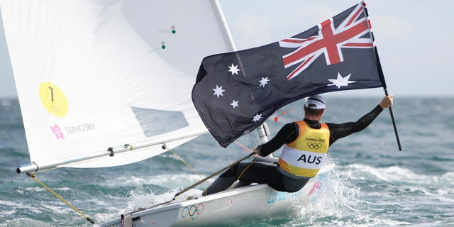 Australia's Tom Slingsby celebrates after winning the gold medal of the laser class sailing competition at the London 2012 Summer Olympics, Monday, Aug. 6, 2012, in Weymouth and Portland, England. (AP Photo/Francois Mori)