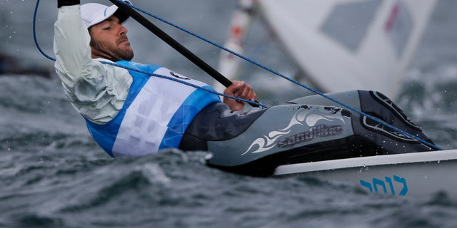 Cyprus' Pavlos Kontides competes during the laser class race at the London 2012 Summer Olympics, Saturday, Aug. 4, 2012, in Weymouth and Portland, England. (AP Photo/Bernat Armangue)