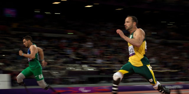 Sept. 2, 2012: Brazil's Alan Fonteles Cardoso Oliveira, left, runs in to win the gold medal and beat South Africa's Oscar Pistorius, right, who took the silver medal in the men's 200m T44 category final during the athletics competition at the 2012 Paralympics in London.