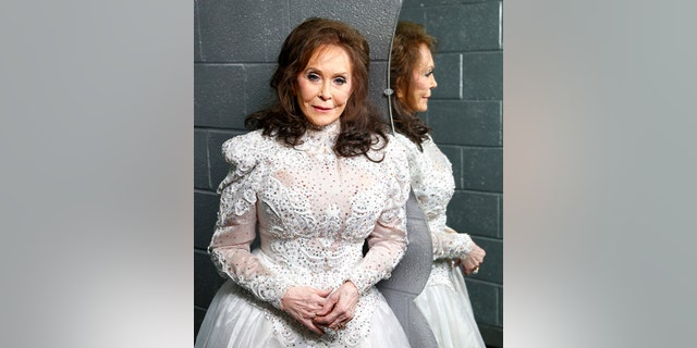 In this Feb. 10, 2016 photo, Loretta Lynn poses for a photo at the Municipal Auditorium in Nashville, Tenn. The country icons Appalachian musical roots are explored on a new American Masters documentary on PBS as well as her first new studio album in a more than a decade, Full Circle, both debuting on March 4.