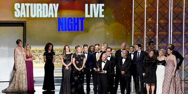 """Lorne Michaels and the cast of SNL accept the award for outstanding variety sketch series for """"Saturday Night Live"""" at the 69th Primetime Emmy Awards on Sunday, Sept. 17, 2017, at the Microsoft Theater in Los Angeles. (Photo by Chris Pizzello/Invision/AP)"""