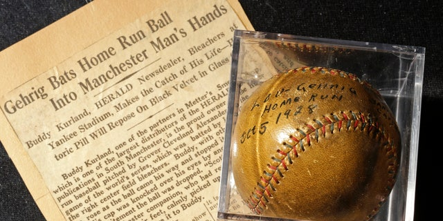 July 5, 2012: A baseball that New York Yankees slugger Lou Gehrig hit for a World Series home run in 1928 is on display at a convention center in Kansas City, Mo.