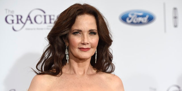 """FILE- In this May 24, 2016, file photo, Lynda Carter arrives at the 41st annual Gracie Awards Gala at the Beverly Wilshire Hotel in Beverly Hills, Calif. Carter has confirmed reports that she has been cast as the president in the second season of the CW series, """"Supergirl.""""(Photo by Chris Pizzello/Invision/AP, File)"""