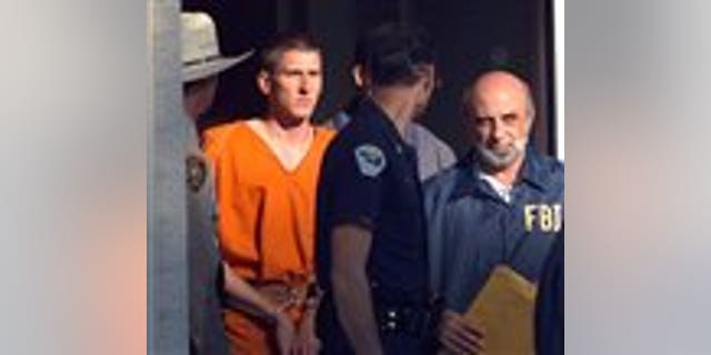 FILE - In this April 21, 1995 file photo, Timothy James McVeigh is lead out of the Noble County Courthouse by state and federal law enforcement officials in Perry, Okla., after being identified as a suspect in the bombing of the Oklahoma City Federal building. McVeigh was sentenced to death and executed. (AP Photo/John Gaps III)