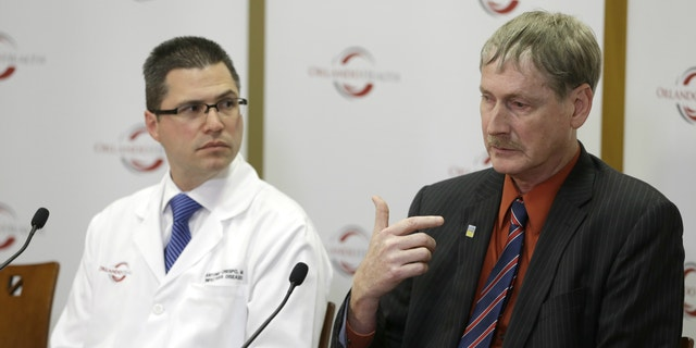 Dr. Kevin Sherin, right, the health officer for the Florida Department of Health in Orange County speaks as Dr. Antonio Crespo, left, the chief quality officer at Dr. P. Phillips Hospital listens, at a news conference to provide an update on the first MERS, or Middle East Respiratory Syndrome case in Florida.