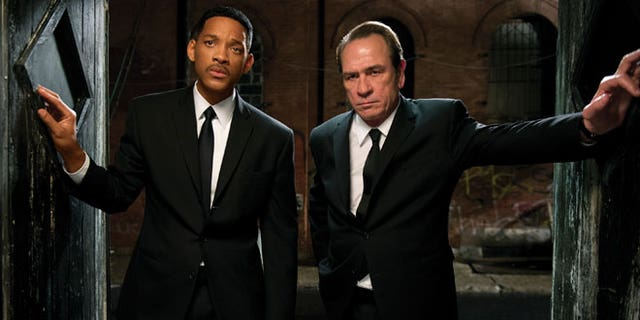 """In this film image released by Sony Pictures, Tommy Lee Jones, right, and Will Smith star are shown in a scene from """"Men in Black 3."""""""