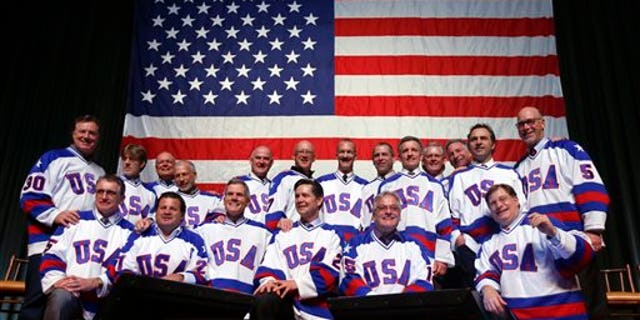 """Members of the 1980 U.S. ice hockey team pose for photos after a """"Relive the Miracle"""" reunion at Herb Brooks Arena on Saturday, Feb. 21, 2015, in Lake Placid, N.Y.  Every surviving member of the hockey team returned to the hockey rink on Main Street they made famous with one of the most memorable upsets in sports history. (AP Photo/Mike Groll)"""