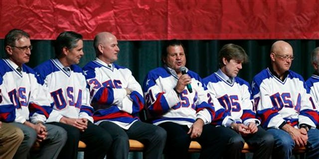 """Mike Eruzione of the 1980 U.S. ice hockey team talks during a """"Relive the Miracle"""" reunion at Herb Brooks Arena on Saturday, Feb. 21, 2015, in Lake Placid, N.Y. Thirty-five years after the team's stunning gold medal at the 1980 Lake Placid Winter Olympics,  the surviving members of the team came together at the hockey rink on Main Street they made famous with one of the most memorable upsets in sports history. (AP Photo/Mike Groll)"""