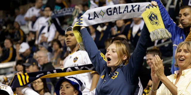March 8, 2014: Los Angeles Galaxy fans cheer before a game against Real Salt Lake in an MLS soccer game in Carson, Calif.  (AP/Reed Saxon)