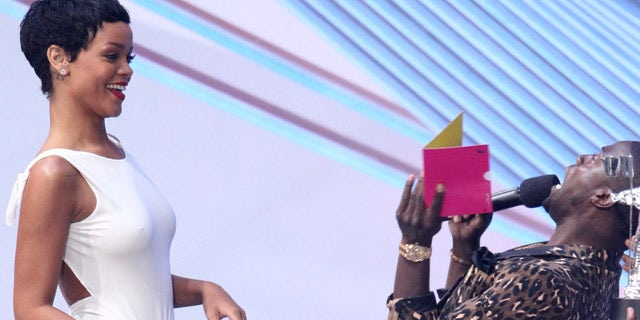 """Sept. 6, 2012: Kevin Hart, right, presents the award for video of the year to Rihanna for """"We Found Love"""" at the MTV Video Music Awards."""