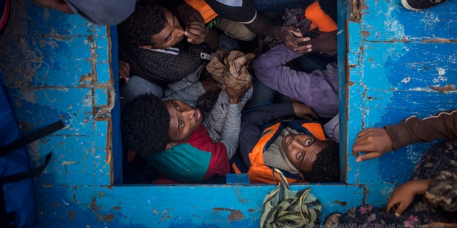 A group of refugees found in unsafe conditions aboard a wooden ship.