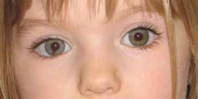 """Missing British toddler Madeleine McCann is seen here in a 2007 photo that seeks to bring attention to the distinctive dark """"smudge"""" within the iris of her right eye."""