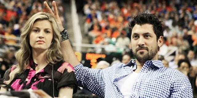 "March 13: ESPN broadcaster Erin Andrews, left, is seen with her ""DWTS"" partner Maksim Chmerkovskiy during the second half of an NCAA college basketball game between Georgia Tech and North Carolina State in Greensboro, N.C."