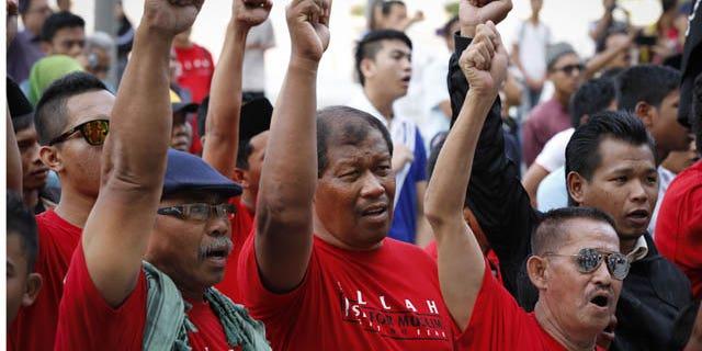 October 14, 2013: Muslim demonstrators chant slogans outside the Court of Appeal in Putrajaya, outside Kuala Lumpur, Malaysia, Monday. (AP Photo)