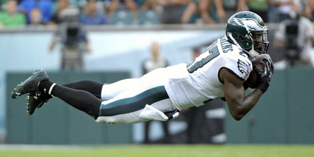 Sep 21, 2014; Philadelphia, PA, USA; Philadelphia Eagles free safety Malcolm Jenkins (27) intercepts a pass in the fourth quarter against the Washington Redskins at Lincoln Financial Field. The Eagles defeated the Redskins, 37-34. Mandatory Credit: Eric Hartline-USA TODAY Sports