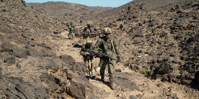 In this photo taken March 8, 2013  by the French Army Communications Audiovisual office (ECPAD) shows French soldiers patrolling in the Mettatai region in northern Mali. France's Presidential office on Saturday March 23 2013 said that DNA testing has shown that Al-Qaeda-linked North African warlord Abou Zeid was killed in combat with French troops in Mali in February.