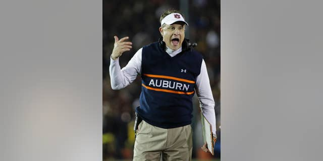 FILE - In this Jan. 6, 2014, file photo, Auburn head coach Gus Malzahn yells during the first half of the NCAA BCS National Championship college football game against Florida State in Pasadena, Calif. Malzahn has a long way to go to challenge Alabama coach Nick Saban's résumé that includes three national titles at Alabama and one at LSU. His Tigers open against his home state team, Arkansas, on Saturday Aug. 30, 2014.(AP Photo/David J. Phillip, File)
