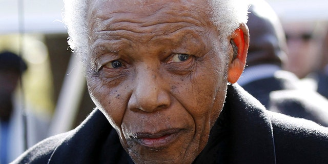 June 17, 2010: Former South African President, Nelson Mandela  leaves the chapel after attending the funeral of his great-granddaughter Zenani Mandela in Johannesburg, South Africa.