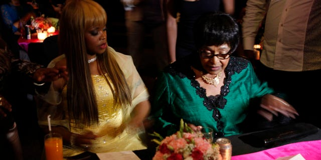 "Nov. 12, 2013: Author Zoleka Mandela, left, granddaughter of former president Nelson Mandela, and Winnie Madikizela-Mandela, right,  Nelson Mandela's former wife,  attends the launch of Zoleka's book ""When Hope Whispers,"" in Johannesburg."